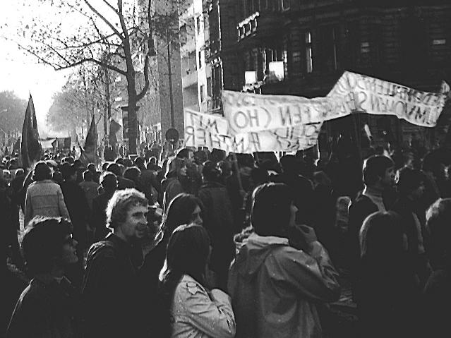 Marchers gather in bright sunlight.